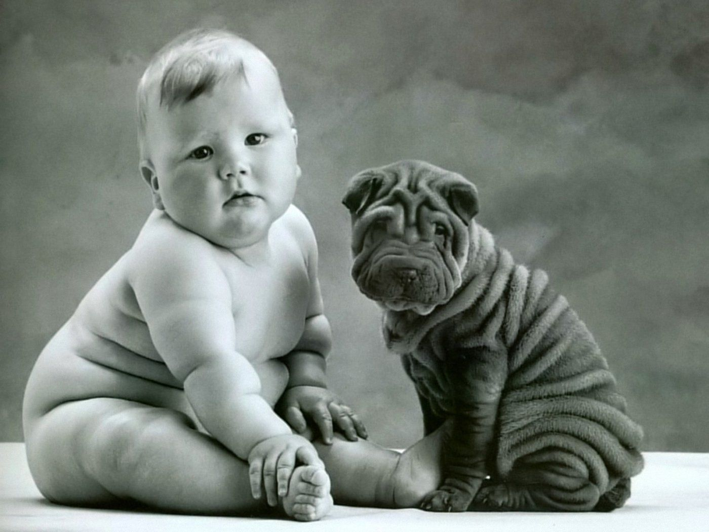 baby-and-puppy_90281-1400x1050